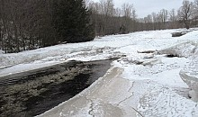Ice jammed the Salmon River, and it jumped its banks, flooding out Lower Park Street in Malone.  Photo: Julie Grant