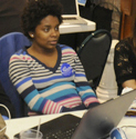 Owens intern Kim Belizaire waits nervously for returns Tuesday night.  Photo:  Mark Kurtz