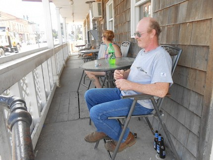 Robert Johnston works at Jericho Joe's on Main Street. He says many of the nice houses and lawns there are thanks to prison jobs. Photo: Natasha Haverty