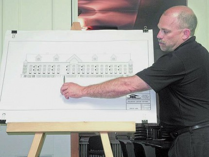 Chris LaBarge describes an architectural rendering of his proposed 90-room hotel on Lake Flower at Wednesday night's Saranac Lake planning board meeting. Photo: Chris Knight, courtesy <em>Adirondack Daily Enterprise</em>