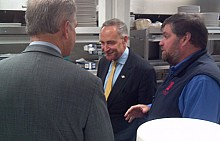 Rep. Bill Owens (L), Sen. Charles Schumer (center) and Lake Placid Pub and Brewery owner Chris Ericson.  Photo:  Brian Mann