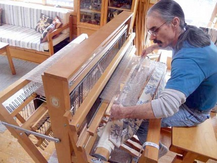 Mike Barsuglia became a full-time rug weaver when he quit his job at the Post Office a few years ago.