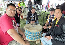 Gabe Gaudette (left) and members of Bear Creek pow wow group. Photo: David Sommerstein