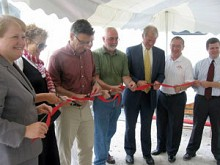 The ceremonial opening of the mobile slaughterhouse. Assembly member Addie Russell, NCPR GM Ellen Rocco, Syracuse University Professor Rick Welsh, Clarkson University President Tony Collins, Canton Town Supervisor David Button, St. Lawrence IDA CEO Patrick Kelly. Photo: Julie Grant