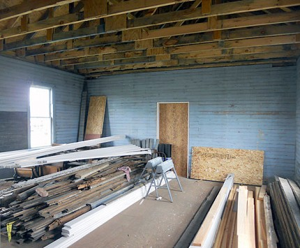 The original 1850 floorboards and ceiling are being replaced this summer.  The school room will eventually have period desks, a blackboard and wood stove.   Photo:  Todd Moe