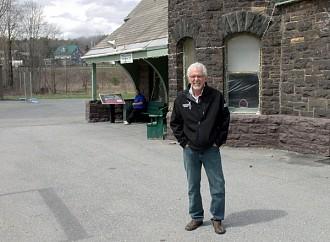Moriah town supervisor Tom Scozzafava, outside town hall. The railroad tracks run yards from the town hall. Photo: Brian Mann