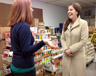 Congressional hopeful Elise Stefanik (at right) tours the Urban Mission in Watertown. NCPR file photo: David Sommerstein.