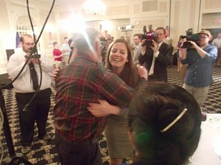 Elise Stefanik is greeted with a hug as she enters her Glens Falls headquarters just before the polls closed. Photo: Brian Mann