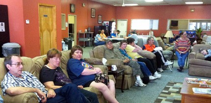 People relax and watch The Price is Right at the Step by Step drop-in center in Ogdensburg. Photo: Julie Grant