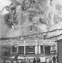 Smoke pours from the St. Regis Hotel in Saranac Lake, which was consumed by fire on Jan. 14, 1964, in this image taken from the April 1964 cover of <em>Fire Engineering</em> magazine. Photo courtesy Saranac Lake Volunteer Fire Department