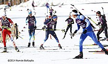 USA's Tim Burke,center bib 67, in a scramble of biathletes training for the Mens 10km Olympic sprint Friday. Photo: Nancie Battaglia