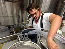 Travis Pierce says kegging is basically tapping a keg, in reverse. Photo: David Sommerstein
