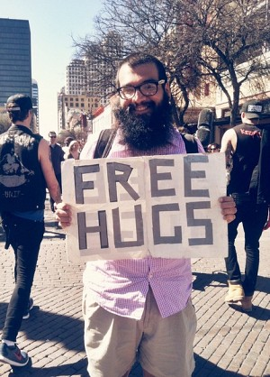 "Victor Ituarte has been giving free hugs at the festival for 6 years. ""Happy South-By!"" Photo: Zach Hirsch"