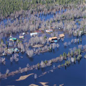 Flooded homes last week in Tupper Lake. Photo: Jim Bisson.