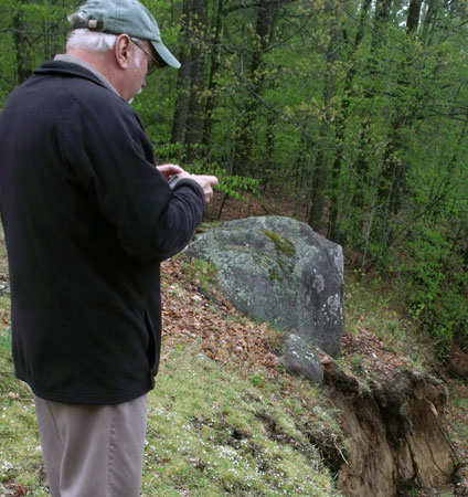 Keene supervisor Bill Ferebee next to a boulder that's about to give way (Photo:  Brian Mann)