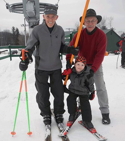 Jack Fogarty, left, and his grandson Paul take the first ride up the new T-bar lift at Mount Pisgah Ski Center, with help from Pisgah Manager Charlie Martin. Photo: Chris Knight, courtesy Adirondack Daily Enterprise