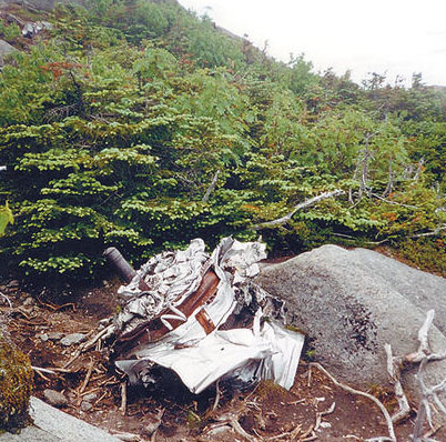 The mangled remains of an engine of a B-47 bomber sits among the rocks on the summit of Wright Peak. Photo: Chris Knight, courtesy <em>Adirondack Daily Enterprise</em>.