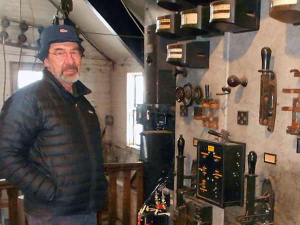 Matt foley checks the meters at his power plant in wadhams ny photos