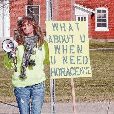 Celeste Beeman of Port Henry, a certified nurse's assistant at Horace Nye, protests the sale outside the Essex County Courthouse. Photo: Chris Morris, courtesy <em>Adirondack Daily Enterprise</em>