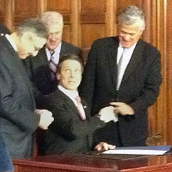 Gov. Cuomo and legislative leaders at the budget signing. Photo: Karen DeWitt