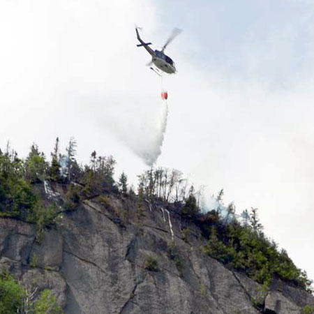 The helicopter at work over Sawteeth Mt. Photos courtesy Adirondack Daily Enterprise