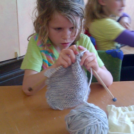 Apollonia Bingham-Bianco, at work on her first-grade knitting project: the hat. Photo: Linda Lutton/Front and Center