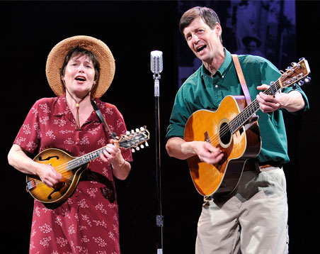 "Darcie Deaville and David Lutken sing ""Jolly Banker in the Lyric production of ""Woody Sez."" Photo: Wendy Muntz"