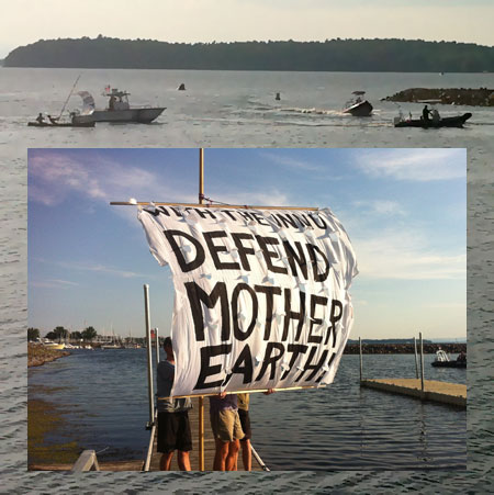 Protester sail canoe, escorted by State Police boat into the Burlington waterfront, and their sail (detail).