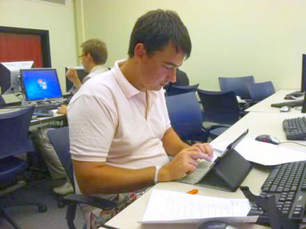 Russian graduate student Filipp Banfilov takes a test in his digital forensics course at UAlbany. Photo: Marie Cusick, Innovation Trail