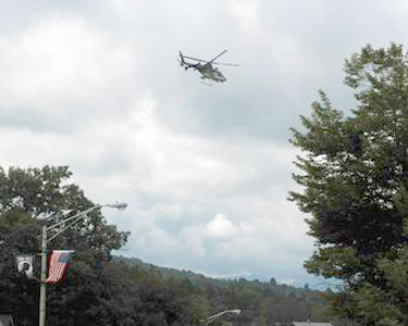 A police helicopter searches for Seth Kilburn over Lake Placid Wednesday. Photo: Richard Rosentreter, Courtesy Adirondack Daily Enterprise.
