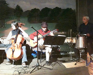 Members of the Caramelo Trio on stage