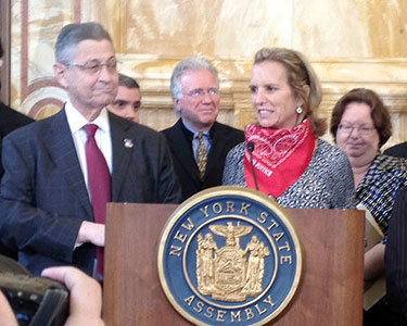 Assembly Speaker Sheldon Silver shares the podium with farmworker rights activist Kerry Kennedy. Photo: Karen DeWitt