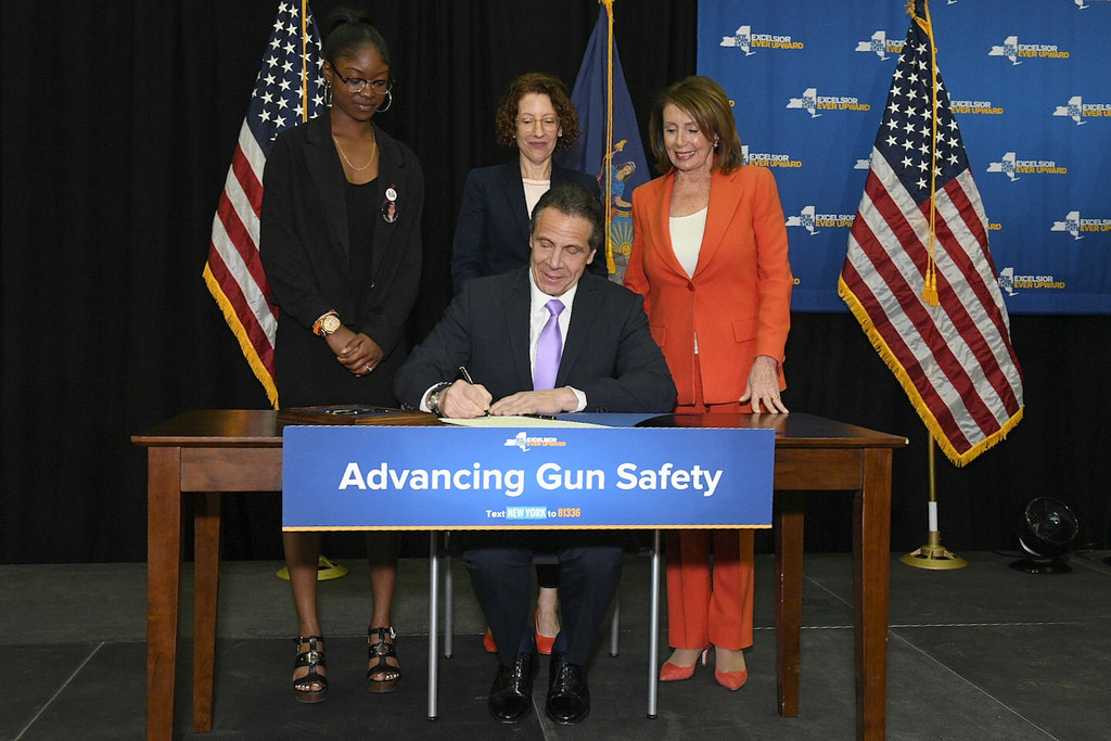 Cuomo signs NY law requiring domestic abusers to give up guns
