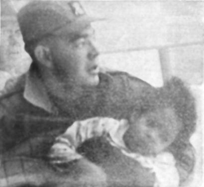 Saranac Lake firefighter Preston Burl carries 4-year-old Ruth King after rescuing her from a fire that destroyed the St. Regis Hotel on Jan. 14, 1964. Photo: Adirondack Daily Enterprise