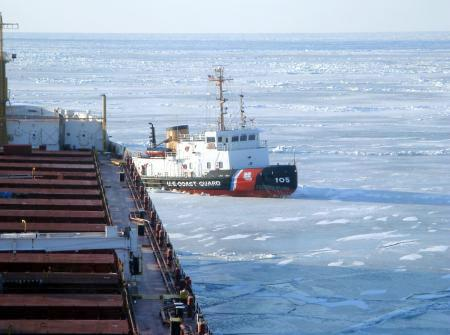 The crew of Coast Guard Cutter <em>Neah Bay</em>, homeported in Cleveland, works to keep the <em>CSL Laurentien</em> moving during an escort in eastern Lake Erie March 27, 2014. Photo: courtesy USCG