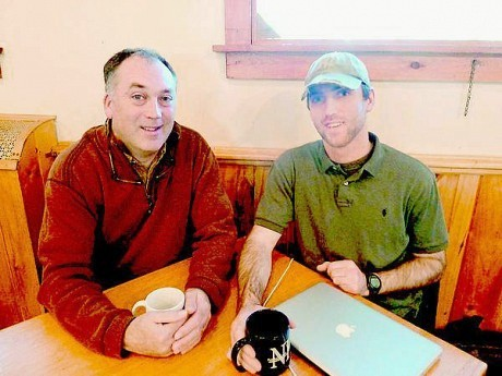 Ray Scollin, left, and his son Matt, seen here at the Blue Moon Cafe in Saranac Lake on Saturday, worked for different sides during the election, but they say the experience brought them closer together. Photo: Chris Morris, courtesy <em>Adirondack Daily Enterprise</em>