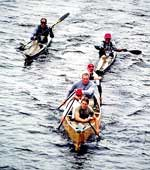 Brian McDonnell in a war canoe during the 90 Miler
