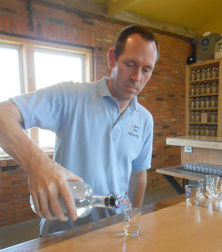 Michael Aubertine pours out a sample of one of his spirits at the Clayton Distillery. Photo: Joanna Richards