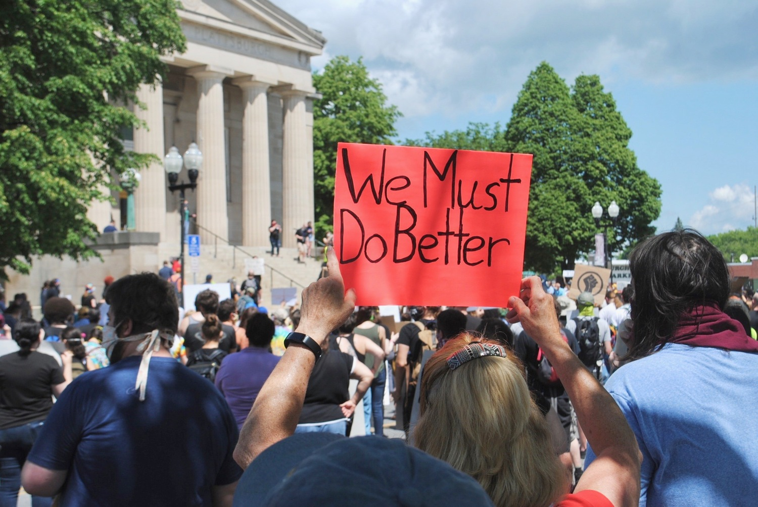 A sign held up at the Black Lives Matter protest in Plattsburgh in June 2020, just days after George Floyd was killed by police in Minneapolis. Photo: Emily Russell