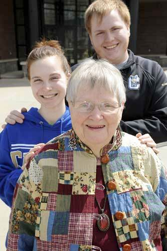 Myrtle Butterfield, with her great-granddaughter Jamie (left) and great-grandson Carter. All are attending SUNY Canton. Photo: Gregory Kie