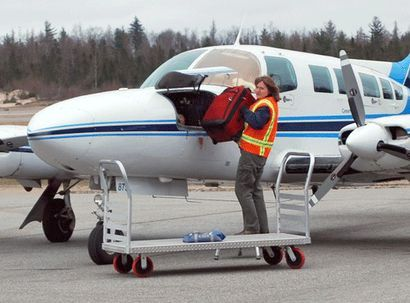"A Cape Air worker unloads luggage from one of the airline's nine-seat Cessna 402 airplanes from Boston at the Adirondack Regional Airport in Lake Clear in April 2012. Photo: Chris Knight/<a href=""https://www.adirondackdailyenterprise.com/"">Adirondack Daily Enterprise</a><br />(Enterprise photo -- Chris Knight)"