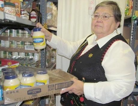 Church and Community Program Director Catherine Matthews is pleased to have mayo to distribute. Photo: Julie Grant
