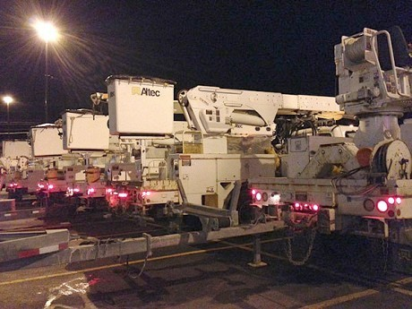 """Cherry picker"" trucks for National Grid get ready for a long night of restoring power in the Price Chopper parking lot in Canton. Photo: David Sommerstein"