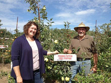 Wendy Oakes-Wilson and Darrell Oakes at a key intersection in their u-pick orchard. Photo by Ashley Hirtzel