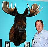 "Remington Director Lowell McAllister with ""Matthew Moose"" in the new Eva Caten Remington Education Center"