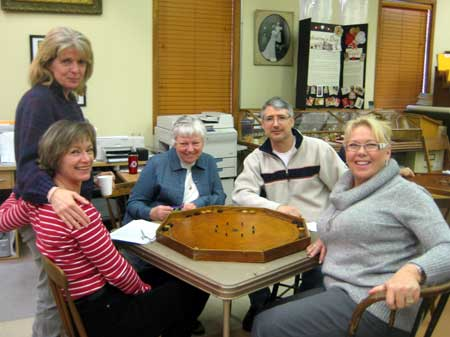The family game at the Osgoode Tournament: Miriam Brown (standing), Debbie Lewis, Heather Bellinger, Louis Gauthier and Leona Cameron. (photo by Lucy Martin)