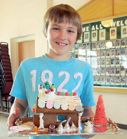 Liam Rodee, age 9, with his creation at the TAUNY workshop. Photo: Julie Grant