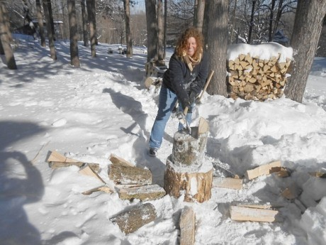 Joanna Richards learns wood splitting at a workshop for women. Photo: Chelle Lindahl
