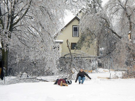 Kids play amid downed tree limbs in Watertown after last month's ice storm. Photo: Joanna Richards