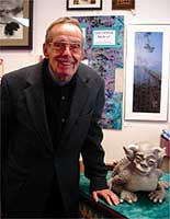 Max Coots and one of his sculptures at the St. Lawrence County Arts Council in Potsdam.